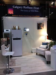 Calgary Radiant Heat home show booth display with white colour scheme of Viessmann boiler system and cross connection control device on display..